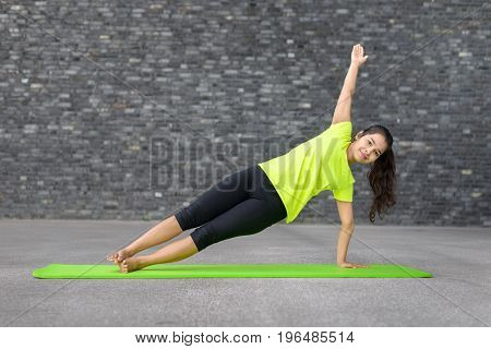 Fit Sporty Young Woman Doing Yoga Exercises