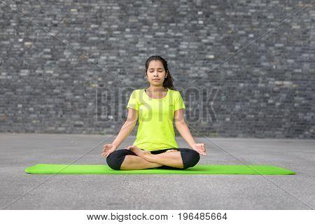Attractive Spiritual Young Woman Doing Yoga