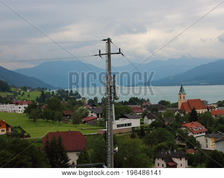 Mobile Cell Phone Ashore Distribution Mast with Sea and Mountain Background