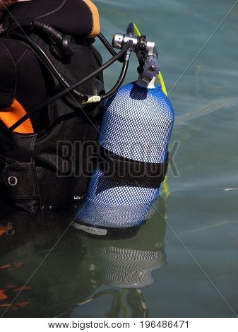 Closeup on Scuba Diving Equipment on backside of Diver in Water
