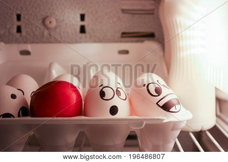 Face Eggs Are Funny In The Fridge. Photo