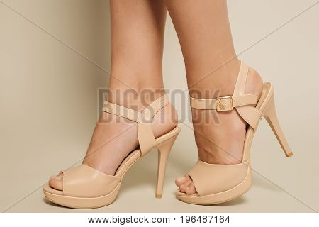 Beautiful Female Feet In Brown Sandals With High Heels