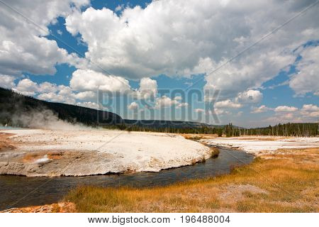 Iron Spring Creek and Cliff Geyser in Black Sand Geyser Basin in Yellowstone National Park in Wyoming USA
