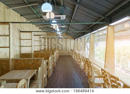 Trendy interior design wooden versatile room decorated together with glass windows