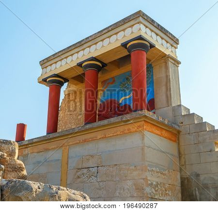 Scenic ruins of the Minoan Palace of Knossos.North entrance with bull fresco. Heraklion.Crete island. Greece.Europe