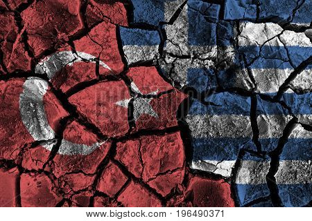 Turkey and Greece flag on cracked ground . Confliction and crisis concept .