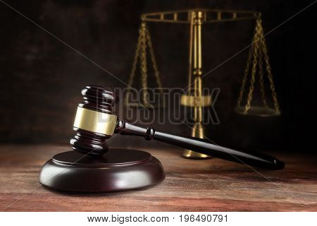 Judge Gavel And Scales On A Wooden Desk, Symbol For Balance And Power In Law And Court, Dark Backgro