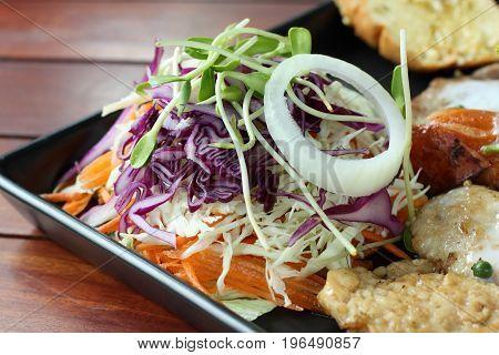 Fresh vegetable salad as side dish on steak recipe.