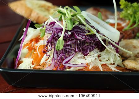 close up of fresh vegetable salad as side dish.