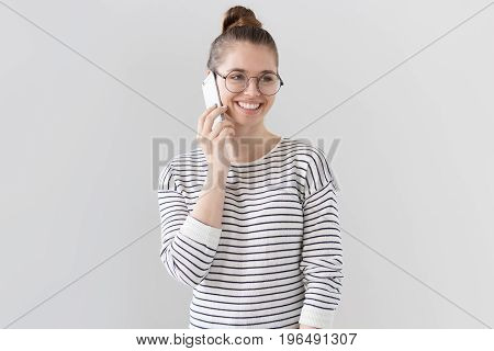 Indoor Photo Of Nice Young European Female Standing Isolated Against Gray Background In Big Round Gl