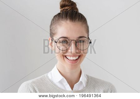 Indoor Shot Of Attractive Young European Brunette With Green Eyes Isolated On Grey Background, Hair