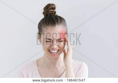 Beautiful Young Woman Squeezing Face Because Of Strong Pain, Putting One Hand To Head, Screaming And