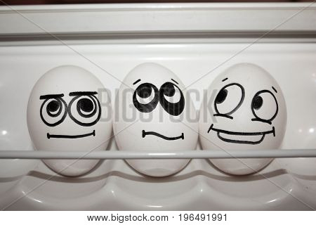 Concept Of Envy. Three. Funny Eggs Together