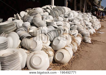 a great number of white bowls pile up in market