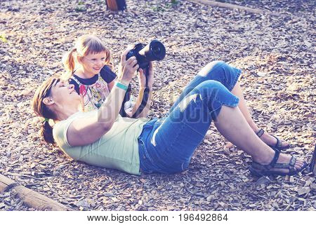 Smiling Little Girl With Her Happy Mother Are Make Photo