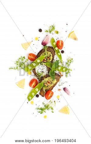 Three Sandwiches With Pesto Sauce And Creamy Cream Served With Young Green Peas On A White Backgroun