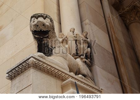 SPLIT, CROATIA - SEPTEMBER 11, 2016: It is a lion of Romanesque style at the entrance to the cathedral of Saint Dominius.