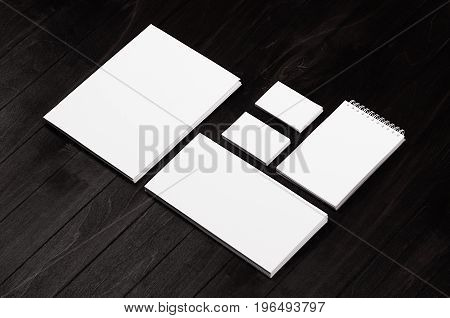 Branding stationery mockup scene on black wooden plank blank objects for placing your design.