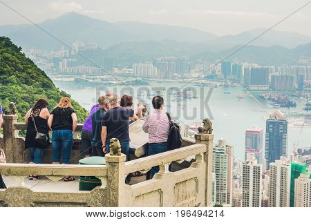 HONG KONG - NOV 15 2014: Tourists at Victoria Peak in Hong Kong. Victoria Peak is one of the most popular spot among tourist visiting Hong Kong.