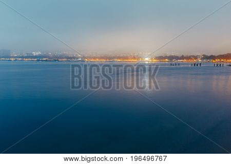 City By The Sea At Sunset In Fog On Background Of Harbor. Picturesque Evening Landscape. Gelendzhik Russia