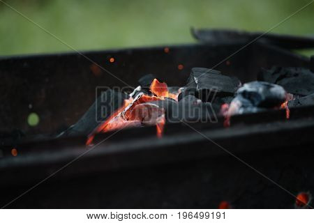 hot charcoal in brazier for bbq, closeup photo