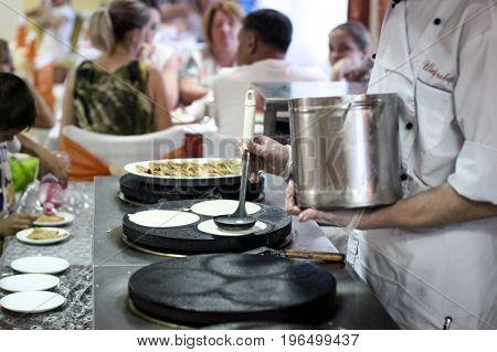 cooking pancakes, baking pancakes, toasted pancakes, chef preparing food