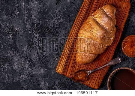 Fresh Croissant On Dark Background.