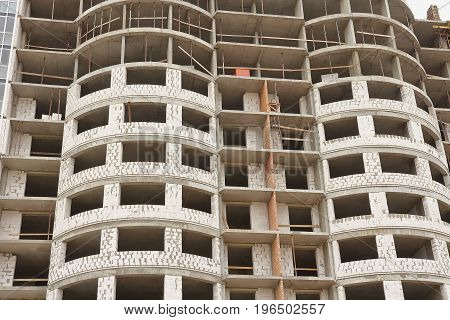 Construction of multi-storey residential building close-up. New housing. The concept of construction.