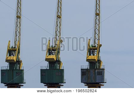HARBOR CRANES - Cranes at the harbor quay for cargo handling at the maritime port