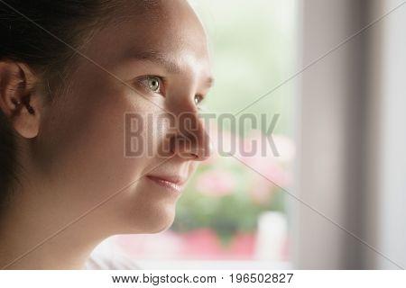 teen girl indoor portrain in kitchen near window, shallow focus