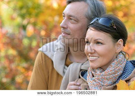 Portrait of  happy couple  posing in park outdoors