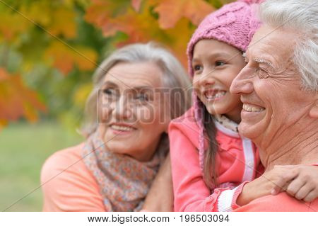 Family portrait of happy grandparents and granddaughter