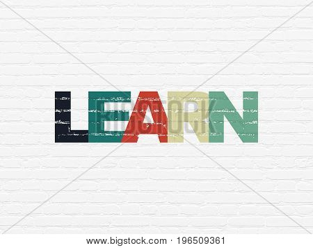 Studying concept: Painted multicolor text Learn on White Brick wall background
