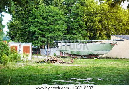 a boat being repaired on dry land