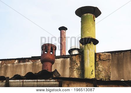 different kind of chimneys on the rooftop