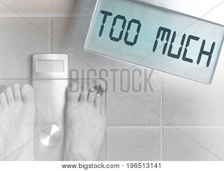 Man's Feet On Weight Scale - Too Much