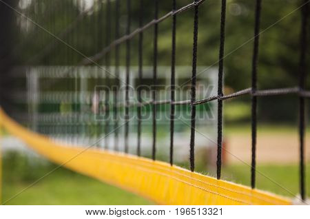 a volleyball net in park outdoor field