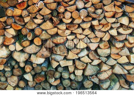 A woodpile of firewood beautifully pinned and laid.