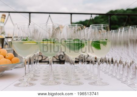 Lemonade with lime and mint in bocals for the wedding catering