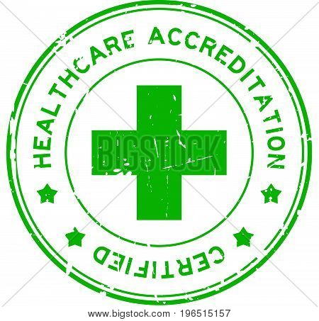 Grunge green healthcare accreditation round rubber seal stamp on white background