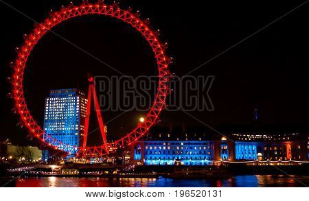London; UK - February 23; 2016: London eye at night. Breathtaking views are available to vistors of London Eye. More than a ferris wheel ride -- London Eye's rotating attraction offers 32 enclosed capsules for full 360 degree views of historic London.