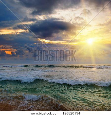 Evening sun set over the tropical ocean.