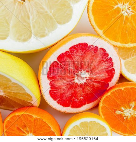 Citrus fruits on white background. Flat lay, top view.