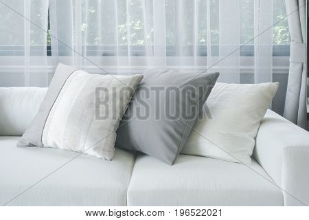 White And Gray Pillows On Sofa In Living Room