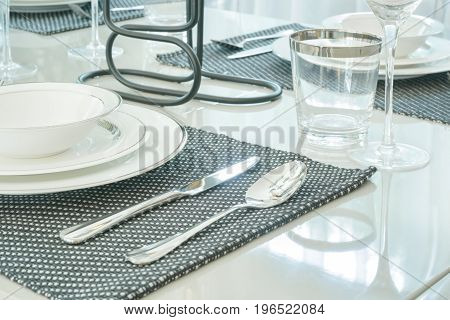 Closeup Spoon And Knife On Dining Table