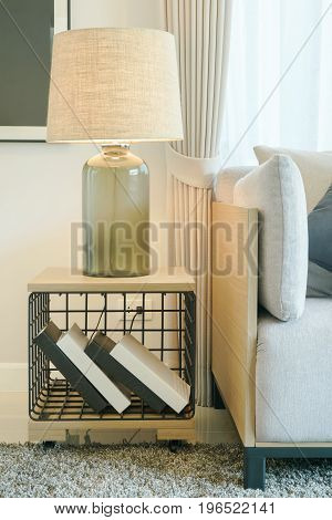 Table Lamp On Wooden Side Table Next To Sofa In Modern Style Living Room