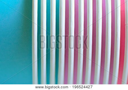 Macro texture of lined up colorful paper cups in horizontal frame