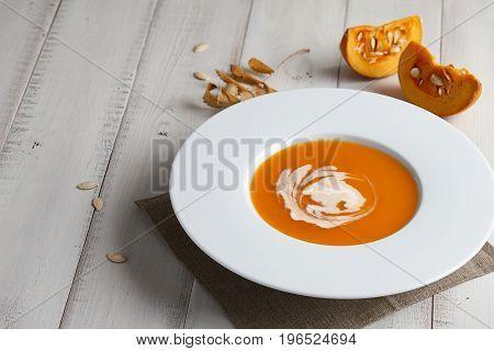 Romantic halloween dinner with pumpkin soup, festive serving