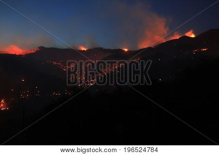 Zrnovnica Split Croatia - July 17 2017: Night vision on mountain Mosor during massive wildfire burning down the forest and villages around city Split