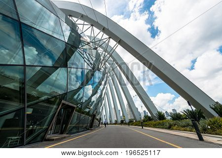 SINGAPORE - MARCH 22 2017: Horizontal picture of of Flower Dome tourist attraction at Gardens by the Bay in Singapore. Futuristic architecture design.